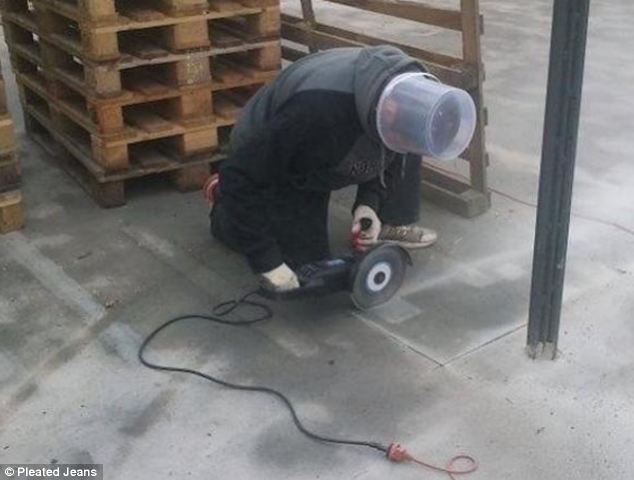 In a bid to protect his eyes while using a power tool a man swaps safety specs for a clear plastic bucket over his head.