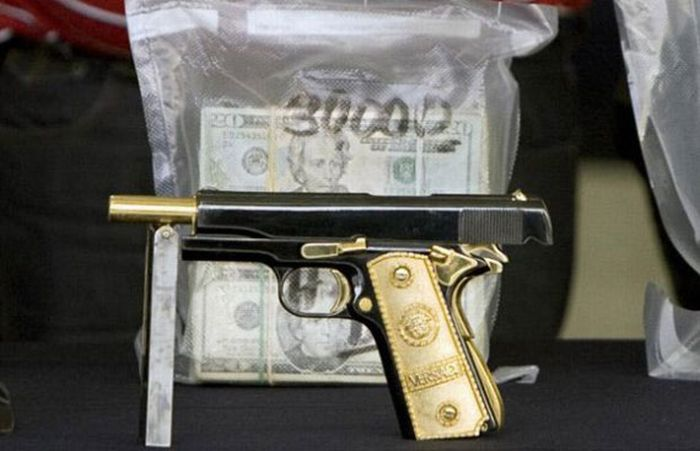 .357 Magnum semi-automatics with solid gold grips.
